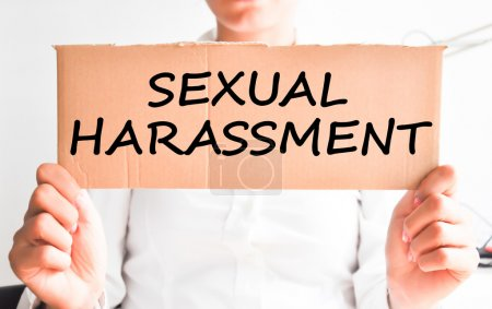 Sexual harassment text on cardboard
