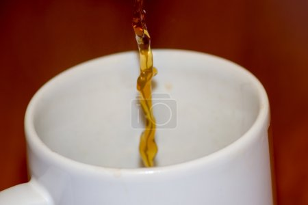 Pouring coffee above background  bean beverage...