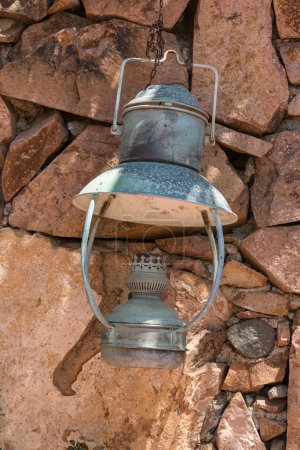 Old Oil Lamp Hanging on a Stone Wall