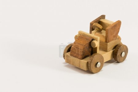 Wooden toy car miniature isolated on white background