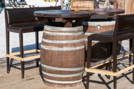 Reserved barrel shaped table in mountain chalet