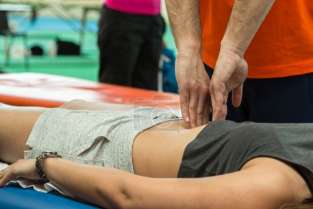 athlete relaxation massage during fitness activity, wellness and