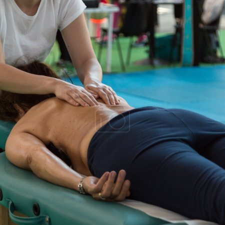 Woman lying on Therapist's Table after Fitness Activity