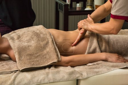 Beautiful Young Woman Having Massage in Groin in a Spa
