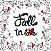 fall in love lettering with twigs and red hearts