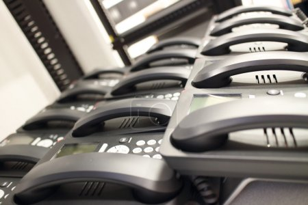 Modern office phones ready to be installed.