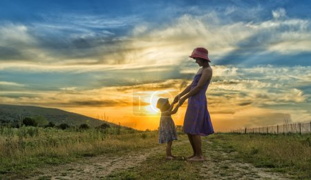 Photo for Happy mother and daughter having fun at sunset - Royalty Free Image