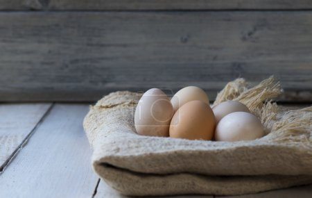 Photo for Bio eggs on wood table - Royalty Free Image