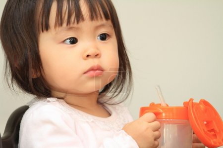 Japanese baby girl drinking water (1 year old)