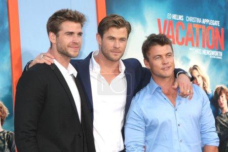 "Photo for WESTWOOD - JUL 27: Liam Hemsworth, Chris Hemsworth, Luke Hemsworth at the ""Vacation"" Premiere, Village Theater,Westwood, CA 07-27-15 - Royalty Free Image"