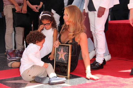 Photo for HOLLYWOOD - AUG 05: Mariah Carey, Moroccan Scott Cannon, Monroe Cannon at the Mariah Carey Star on the Hollywood Walk of Fame, Hollywood, CA 08-05-15 - Royalty Free Image