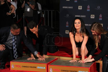 Photo for HOLLYWOOD - SEP 08: Jeremy Scott, Katy Perry at the Jeremy Scott and Katy Perry Handprints in Cement Ceremony, TCL Chinese Theater, Hollywood, CA - Royalty Free Image