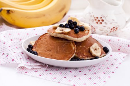 Pancakes with oatmeal, banana and blueberries