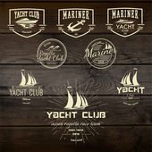 Yacht club badges logos and labels for any use On wooden background texture