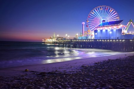 Photo for THe Santa Monica Pier at sunset. Santa Monica is a beach town in Los Angeles, California. - Royalty Free Image