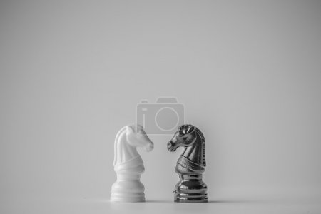 Photo for Chess is an strategy and intelligence board game originated in India that is played between two people on a chessboard - Royalty Free Image