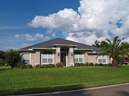 One story Florida home with a stucco facade.
