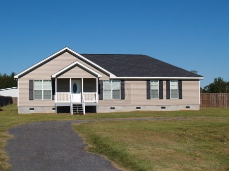 Small low income manufactured home with a covered ...