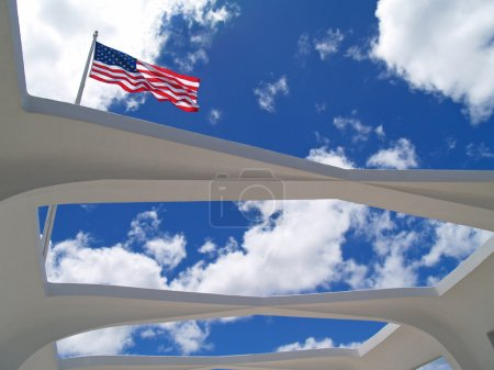 US flag as seen through the unique open roof of the USS Arizona Memorial in Pearl Harbor, Honolulu, Hawaii.