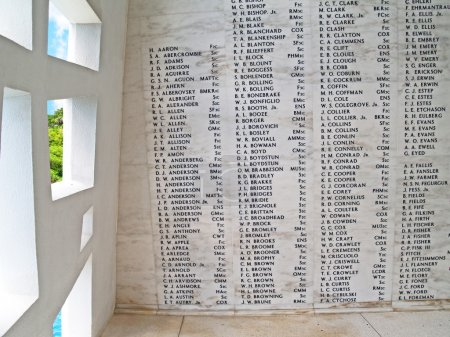Names on the wall of the USS Arizona Memorial  beside a unique window, at Pearl Harbor in Honolulu, Hawaii.