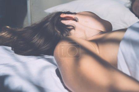 Seductive brunette girl sleeping