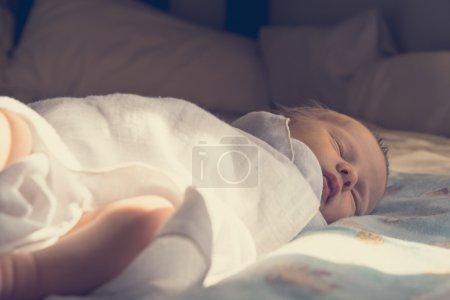 newborn baby sleeping sweetly