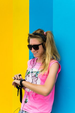 blonde girl posing in sunglasses