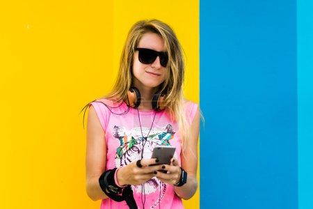 blonde girl posing in sunglasses