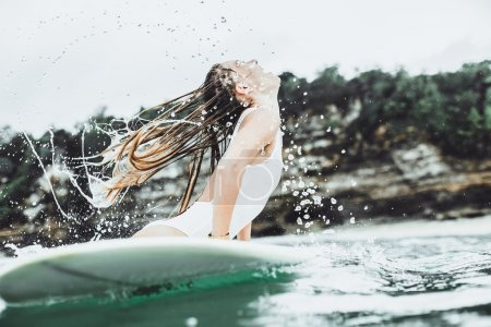 beautiful girl in the ocean Surf in the rain