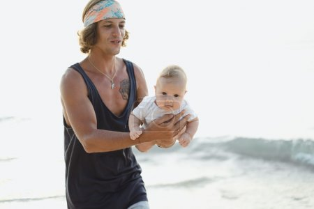 beautiful young father with a child