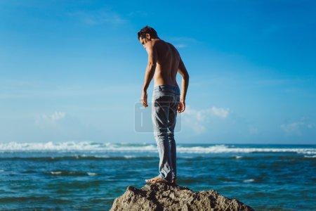 man on the beach on  ocean background