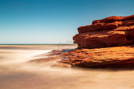 Photo for Long exposure of a clear sunny day at Canada's Prince Edward Island red sandstone cliff, next to the Atlantic ocean. - Royalty Free Image