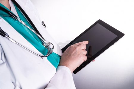 Female Doctor using a Digital Tablet