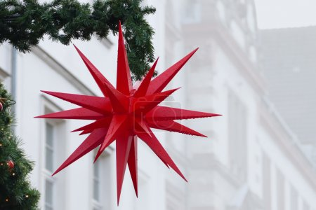 christmas star  with raindrops, street decoration, copy space