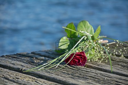 Last love greeting, rose bouquet on the old wooden...