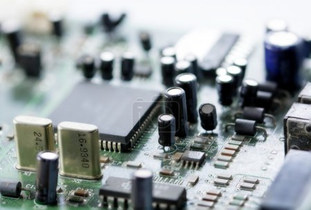 Photo for Macro of an electronic circuit board with processor, small focus, blurred in the in the background - Royalty Free Image