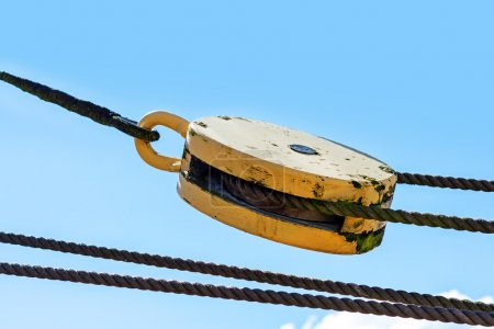 pulley with ropes against the blue summer sky