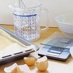 Baking utensils, baking tray with dough, plastic j...