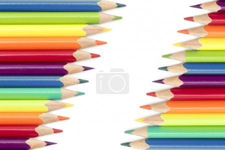 Photo for Crayons or colored pencils in two diagonal rows isolated on a white background with copy space - Royalty Free Image