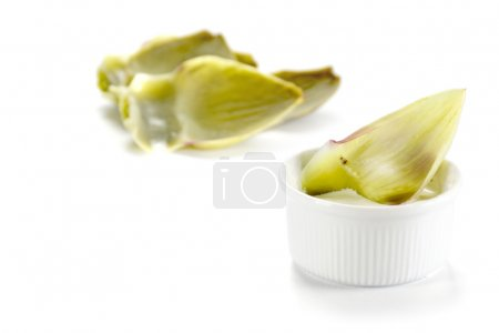 mediterranean appetizer, artichoke leaf in a bowl with dip, isol