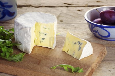 Young soft blue cheese from France with wedge cut,...