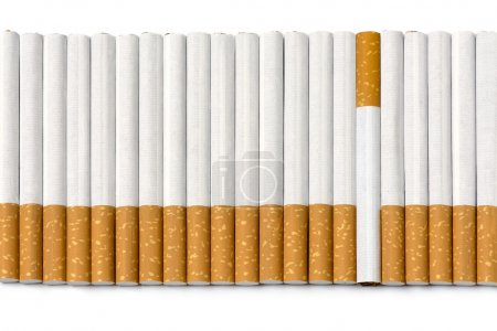 row of filter cigarettes, one is upside down isolated on white