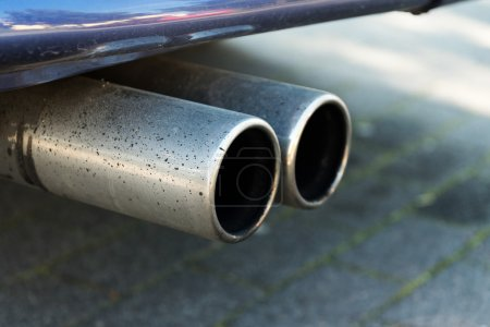 dual exhaust of a car, concept for emissions and particulate mat