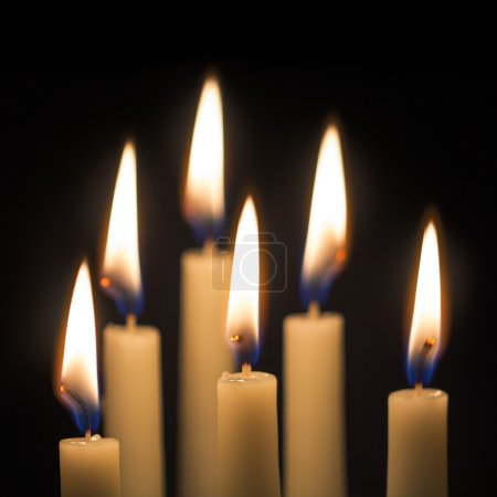 Photo for Group of six burning candles against a black background, selected focus, narrow depth of field - Royalty Free Image