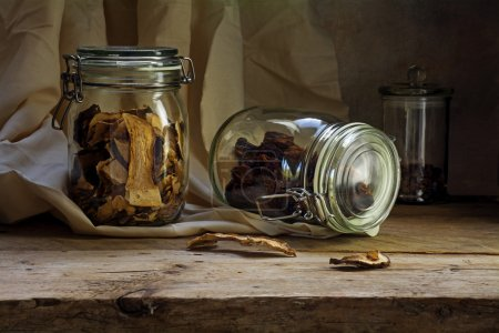 glass jars with dried food on an rustic wooden shelf, countrysid