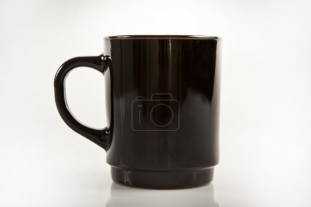 Black mug on a white background