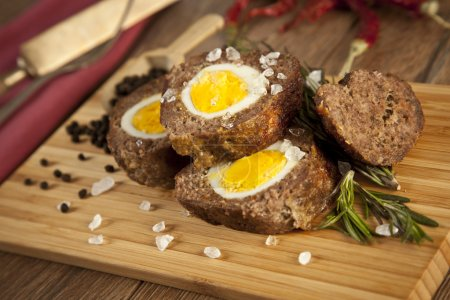Baked meatloaf with boiled eggs for Easter