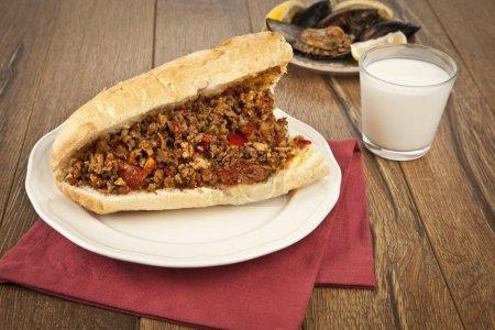 Photo for Turkish Kokorec - lamb intestine food sandwich with midye dolma - Royalty Free Image