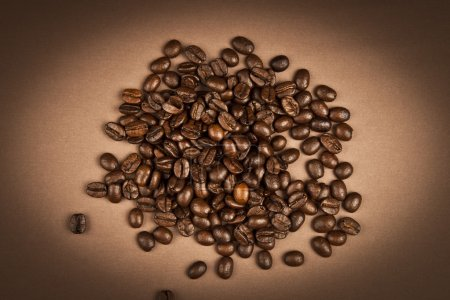 Coffee beans with brown background