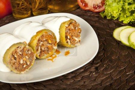 Stuffed zucchini, kabak dolmasi, Turkish and greek cuisine with concept background
